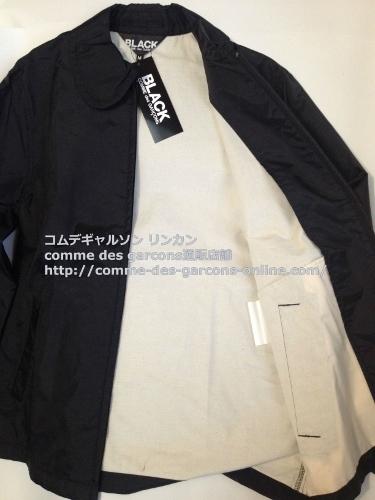 black-cdg-coach-jacket